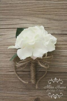 Silk flower white hydrangea boutonniere (white hydrangea with very light pink & green), wrapped in twine. It is perfect for a woodlands or