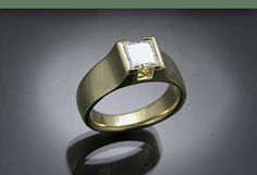 18k heavy weight semi-bezel set with princess cut diamond - almost EXACTLY my engagement ring