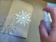 Misted snowflakes on kraft, @barre3danville @jewelsligon they have this spray in aerosol cans at Richard's!