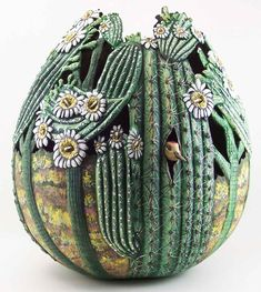 Gourd art.......Saguaro Tree  This won 3rd place in the Master Craftsman category & the Peoples Choice award at the Wuertz Festival 2012, Phyllis Sickles