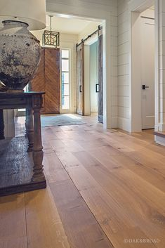Wide Plank White Oak Hardwood Floor By Oak And Broad With Custom Stain | Entryway With Custom Reclaimed Style Wood Door And Iron Door Hardware | Discover more at http://OakAndBroad.com/nashville-tennessee-wide-plank-white-oak-flooring/