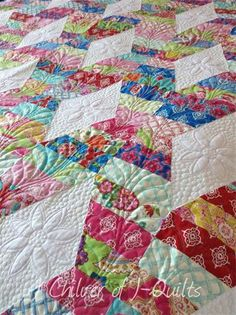 Hugs and kisses strip quilt, close up of quilting, at J-Quilts (UK). It is entirely freehand quilted.