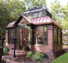 I love the stone and copper accents of this greenhouse