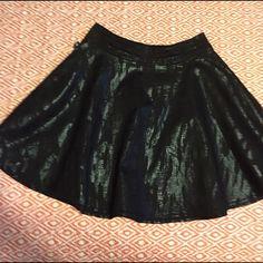 """Snakeskin print skater skirt Sexy Snakeskin print foil black gored skater skirt. Two pockets. Like new. 16"""" waist 18""""length. 61% cotton 37 % polyester 2% spandex Rock & Republic Skirts Circle & Skater"""