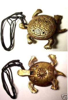 """Handmade in NEPAL. Made of Brass  Lightly blow into turtles head and cover and uncover four holes on top and two holes on bottom to create whistle trill sound.    Pitches produced are not """"tuned musical pitches"""", however. Whistle would be used more for rhythmic timing rather than melody playing similar to a Samba Whistle.    Turtle has a patterned shell with small holes to alter the pitch. Turn over to find a sun motif. Black cord. 3 1/2 in. long x 2 3/4 in. wide x 1/2 inch high  -ebay"""