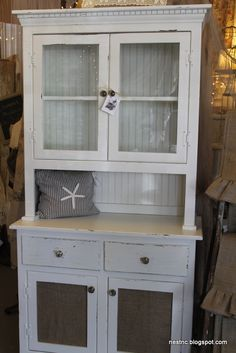 country cupboard- this would be perfect for a coffee/tea bar, mugs could go in the cabinet