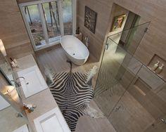 natural shower with zebraskin rug