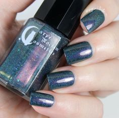 Because She Danced to Space Jam. Polish Info ...This....THIS .. is the most i have ever loved a creation of my own( besides my daughter of course!) This is 'Because She Danced to Space Jam', and it is a beautiful shimmering abyss of magic! Navy base with mutichrome pigment shifting between four stark colors. two types of color shifting flakies are in here as well, in all colors, popping out in any light. crazy linear as well with a smattering of large flake holo pigment to…