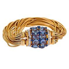 Retro Sapphire Diamond Gold Bracelet   From a unique collection of vintage retro bracelets at https://www.1stdibs.com/jewelry/bracelets/retro-bracelets/