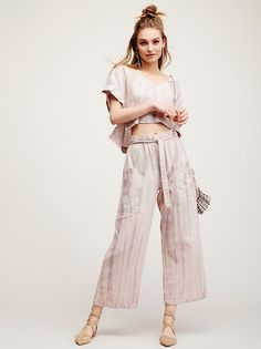 Washed Up Pants   In a tie-dye print these easy-to-wear wide leg pants are featured in a cotton/linen blend. Oversized side pockets and an elastic waistband with drawstring tie.