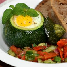 from TheKitchn (they have the best stuff!) - this is little eight-ball zucchini with eggs baked inside.