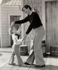 "Shirley Temple and Buddy Ebsen dance to ""At the Codfish Ball"" in a scene from Captain January ( 1935 )."