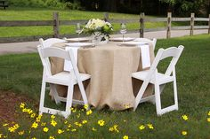 Burlap Table Linen with crisp White Satin Napkins.  Perfect for a rustic wedding theme!