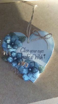 Mdf heart decorated with Dreamees floral stamps and an Inkylicious words stamp.
