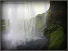 """Walk behind the Seljalandsfoss waterfall of Iceland. Find out more at """"Down the Wrabbit Hole - The Travel Bucket List"""". Click the image for the blog post."""