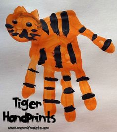 These are adorable!  India Craft | Tiger Handprints | Mommy Maleta