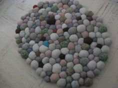"https://flic.kr/p/4yr31b | Felted Stone Rug | over 200 felted ""stones"" sewn together by hand."