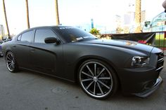 Divine One Customs' Amber Logue was at the 2011 SEMA show in Las Vegas, Nevada to show off one of their newest designs. Dodge Charger Awd, Charger Srt8, My Dream Car, Dream Cars, Matte Black Cars, Daimler Ag, Dodge Avenger, Dodge Chrysler, Hot Rod Trucks