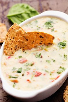 Melty white cheese, spinach, jalapeños, and diced tomatoes come together in this incredible dip!  This is a must make dip ...