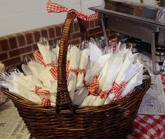Napkins tied with red and white gingham ribbon for BBQ or informal party.