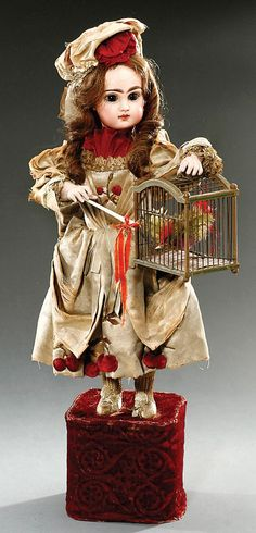 Bebe Cage Automaton by Lambert, circa 1895, with Jumeau bisque head and original costume, 21 inches in height.
