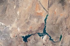 Lake Mead, the man-made reservoir that serves water and electricity through the Hoover Dam to over 20 million residents in Arizona, Nevada, and California is at al all-time low since the Dam was first completed in Human Overpopulation, California Drought, Nevada California, Lake Mead, Earth From Space, Image Of The Day, Geology, Creative Art, Las Vegas
