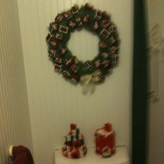 Plastic canvas gifts added to green wreath and package tree with red church toilet paper cover add a nice touch to my bathroom