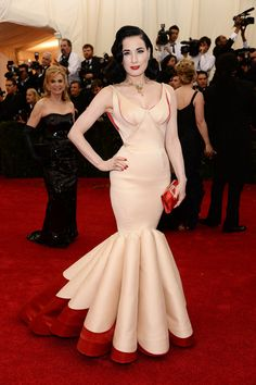 Dita Von Teese's famous curves were on full display in a custom colorblock Zac Posen dress that used scarlet trim to accentuate the cut.