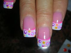 Pink, purple, aqua, and white dotted french tip nail art