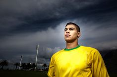 Brazilian football fan with stadium in background.