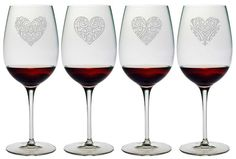 How beautiful are these wine glasses with different heart designs on each glass? Each of these wine glasses is individually sand etched on Bormioli stemware.