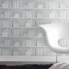 The White Bookshelf wallpaper features white books on white shelves for a bright minimalist look. It can be used to create a stunningly contemporary feel reminicent of designer offices, fashion shoots and art galleries. Perfect for feature walls or a whole room.