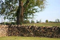 Stacked stone fencing of Bluegrass country. Stone Fence, Brick Fence, Concrete Fence, Front Yard Fence, Pallet Fence, Metal Fence, Fence Gate, Fencing, Fence Stain