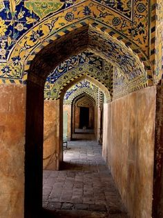 Beautiful perspective on a Moroccan arched walkway - the hand painted tiles make it