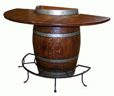 Half Barrel Bistro Table ($798.00): Make the best use of your wall space with this spectacular Half Barrel Bistro Table. Made from a real half section of a recently retired oak wine barrel, these tables have authentic style, right down to the barrel bands