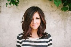 Shoulder-length hair cut with long bangs:: if i ever went shorter hair, this would be it.