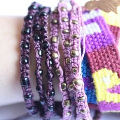 """Aubergine """"Xubal Handmade Triple Wrap Bracelet"""" In Aubergine with black beads, 26"""" around, 100% Poly Waxed Thread, Metal Beads, Handmade by skilled artisans in Guatemala, mix & match! For sale as individuals or with Ketzali """"Tzuel Textile Pouch""""- $32., with Makeup bag- $42, with Makeup bag, Pouch, and 1 Bracelet- $58, with 2 Bracelets- $72. Ketzali Jewelry Bracelets"""