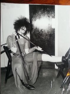 Siouxsie Sioux backstage with a plaster cast. At a Hammersmith Odeon concert on 24 October, 1985 she fell midway through performing 'Christine' and dislocated her kneecap. The plaster was given to BBC Radio 1 for a competition and was won by Barry Hindmarch.