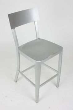 Modern Cafe Dining Chair in Brushed Aluminum - Counter Height by Manhattan Modern. Save 15 Off!. $110.00. Hollow brushed aluminum. Non-marking plastic feet. Modern dining chair, extremely lightweight. Can be used indoors and outdoors. There is no reason to restrict contemporary furniture to the indoors - enjoy it al fresco on your deck, patio, or restaurant with this modern aluminum dining chair. Made of lightweight, versatile brushed aluminum, these chairs can be easily moved...