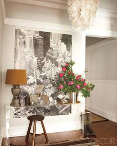 Lucite console table in front of an oversize photograph