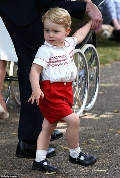 Prince George was in high spirits at his sister Charlotte's christening at Sandringham in ...
