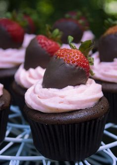 Chocolate Cupcakes with strawberry Cream Cheese Icing...topped with chocolate dipped strawberry!!