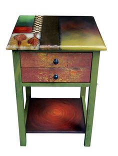 Two-Drawer End Table by Wendy Grossman. Grossman hand paints every surface of this wood table in colorful, original designs with embossed copper accents. Features two drawers and a lower shelf. Choose from two designs: Forest Pool (shown) or Early Autumn (additional image).