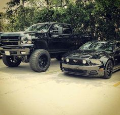 Jacked up black truck and a sleek smooth mustang...these will be in my driveway one day!