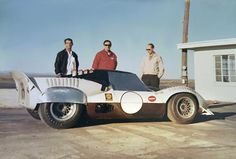 Troy Rogers (left) and Wesley Sweet (center) pose with a Chaparral 2, modified with sheet metal fender flairs and a cardboard and fiberglass coupe roof. This was the first testing done during the development of the Chaparral 2D. Pete Biro photo via Rodney Rogers.
