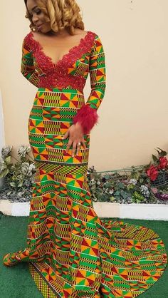 Traditional African wear with a matching dress for the lady.The African wear designs for guys in this look ensures the men keep their favorite khaki African Prom Dresses, African Dresses For Women, African Attire, African Wear, African Women, African Style, Modern African Dresses, African Dress Styles, African Outfits