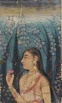 For pretty background blossoms  17th C. Head of a young woman, among flowering stems. Mughal India. Color and gold on paper. less than 2 inches high !  F1907.763