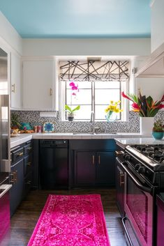 """""""I wanted to paint the lower kitchen cabinets navy or teal, but I thought black would hide the dishwasher and stove better,"""" says Carrie. """"The blue ceiling makes up for it though!"""" They also covered the peeling particle-board countertop next to the stove with a polished marble remnant."""