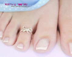 Hey, I found this really awesome Etsy listing at http://www.etsy.com/listing/113047453/sterling-silver-bow-toe-ring
