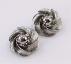 Vintage Silvertone Brushed Textured Flower Silver Tone Pinwheel Spiral Domed Clip On Earrings by ThePaisleyUnicorn on Etsy